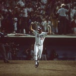 Los Angeles Dodgers Kirk Gibson (23) victorious after hitting game-winning, walk-off home run to win Game 1 vs Oakland Athletics at Dodger Stadium.