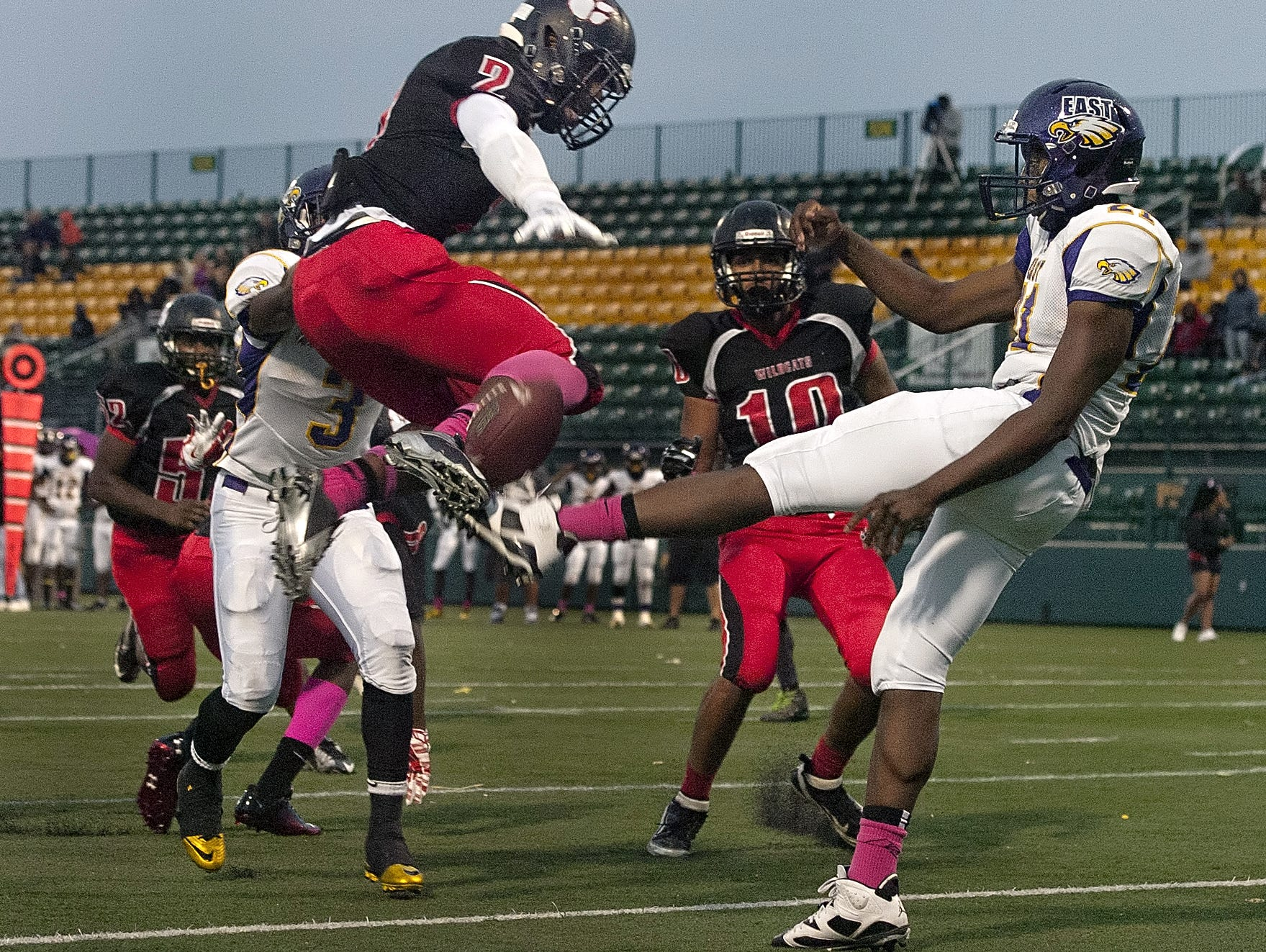 Wilson's Marvin Appleberry, left, blocks a punt by East's Davonte McClary in a RCAC regular-season game last fall at Sahlen's Stadium, which no longer will host the state football semifinals.