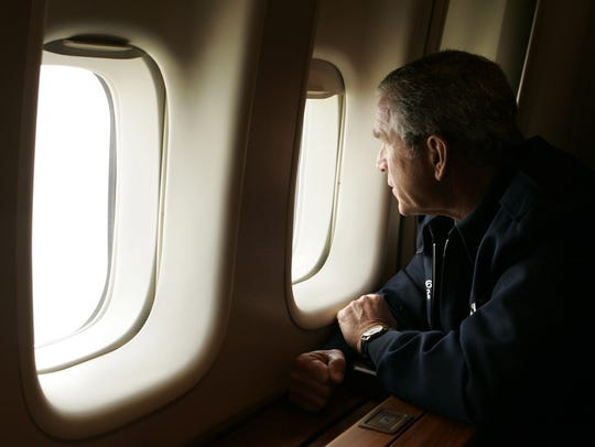 President Bush looks out the window of Air Force One