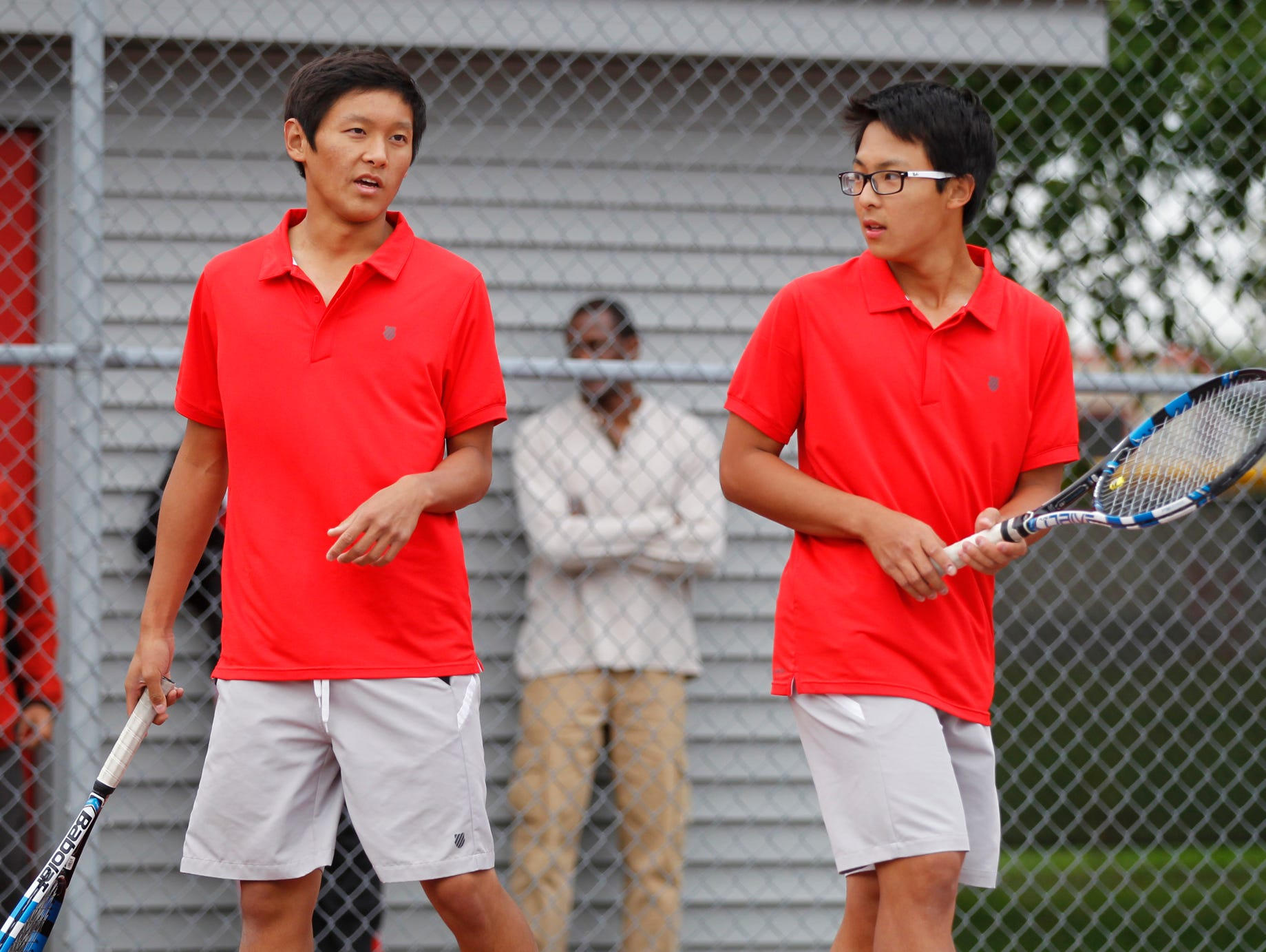 West Lafayette's Jethro Zhou, left, and Brian Mi celebrate a point against Lafayette Jeff's Aden Beaver and Brayden Williams at No. 1 doubles during the boys tennis sectional championship Friday, October 2, 2015, at Cumberland Courts in West Lafayette.