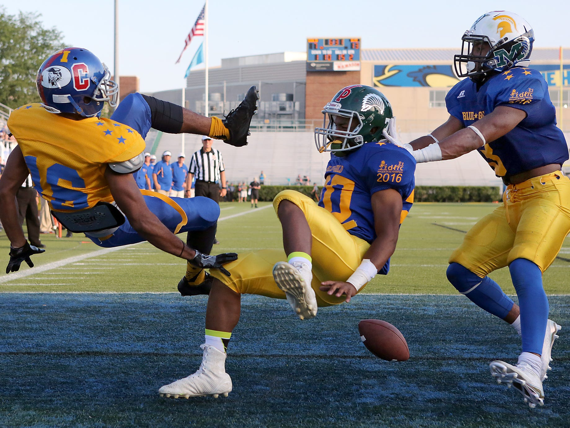 Gold's Cooper Russell of Christiana can't hold on to a pass in the end zone as Blue's Taurus Pinkney of Tower Hill (center) and Trevon Bordrick of Howard converge in the first half of the DFRC Blue Gold All-Star game at Delaware Stadium Saturday. Defensive pass interference was called on the play.