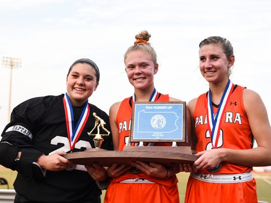 Palmyra captains Cheyenne Sprecher, Katelyn Mark, and Jess Dembrowski  pose for aphotos with the state runner-up trophy.
