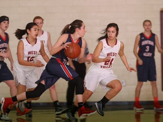 Central Valley's Tayah Ranney, center, takes the ball around West Valley's Tessa Thomsen, second from right, in their game at the West Valley New Year's Hoops Tournament. Ranney was named the 2017 Northern Section MVP.