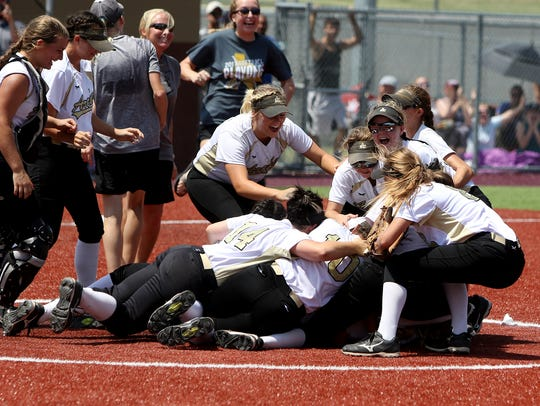 The Archer City Lady Cats celebrate their 4-3 win over