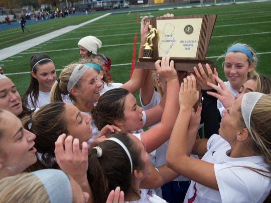 Wall celelbrates with their State Championship trophy.