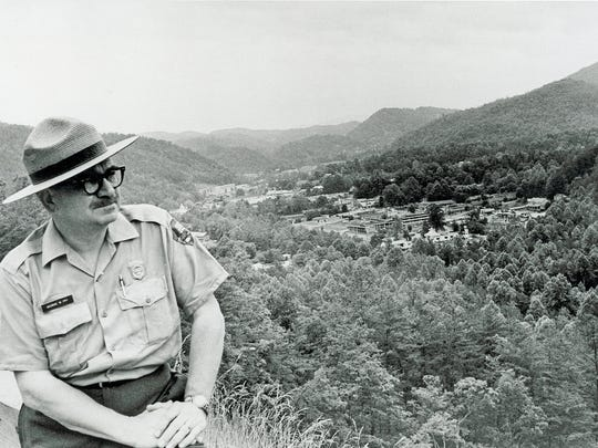 Great Smoky Mountains National Park Superintendent George W. Fry is pictured at the Gatlinburg By-Pass in June 1968, the date the project was completed. Fry, the sixth park superintendent, was active with Great Smoky Mountain Council of the Boy Scouts of America  until his death in 2000 at age 89. He is the father of Georgiana Vines, a political columnist for the News Sentinel and retired associate editor.