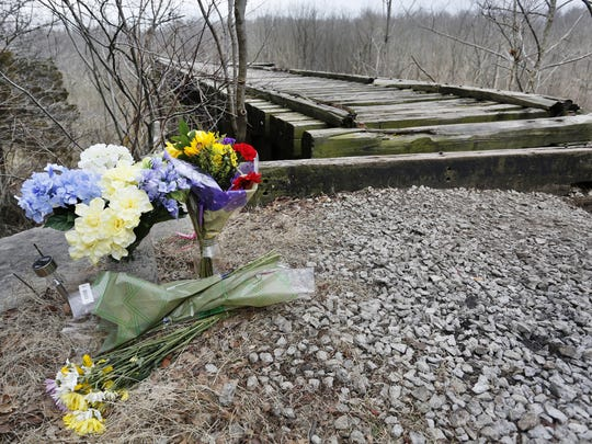 Flowers next to Monon High Bridge in memory of Liberty German and Abigail Williams Tuesday, February 21, 2017, on the Monon High Bridge Trail just east of Delphi. German, 14, and Williams, 13, were hiking the Delphi Historic Trails the afternoon of February 13, but did not show up when relatives arrived later to pick them up.
