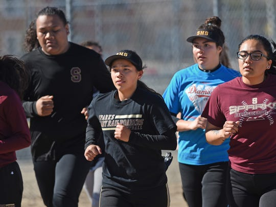 Sparks softball player Angie Hurtado, front and center,  jogs with her teammates during practice at Sparks High School on March 25, 2018.