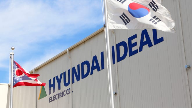 The Ohio state flag and the flag of South Korea fly in front of the Hyundai Ideal Electric. This week, layoff notices were given to 50 employees, but the company is exploring options to keep the Mansfield plant operating.