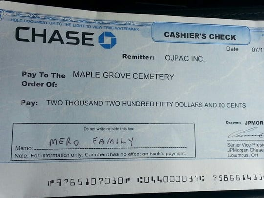 An image of the check for the tot's funeral expenses.
