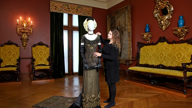 """Leslie Klingner, Biltmore's curator of interpretation. with the dress that Nicole Kidman wore in """"The Portrait of a Lady."""""""