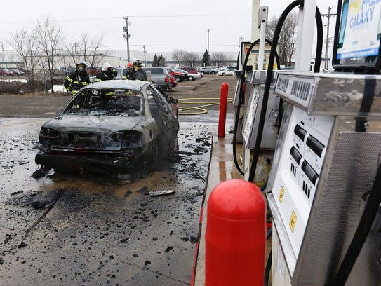 St. Cloud firefighters inspect the damage after a car