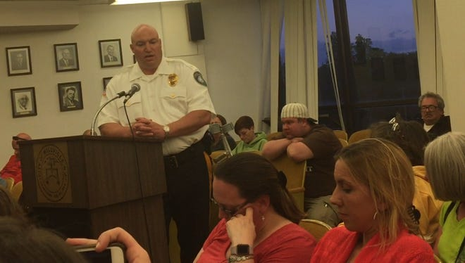 Millville police Chief Jody Farabella responds to residents at Tuesday night's City Commission about a street brawl last week that's tarnished the city's reputation.