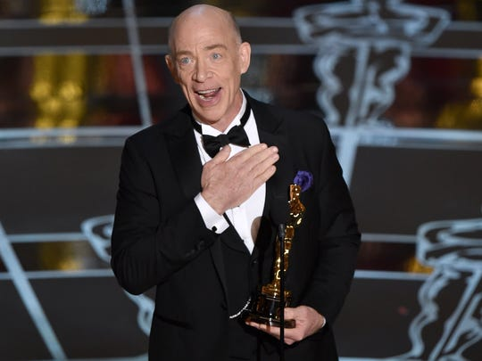 """J.K. Simmons accepts the award for best actor in a supporting role for """"Whiplash"""" at the Oscars on Sunday, Feb. 22, 2015, at the Dolby Theatre in Los Angeles."""