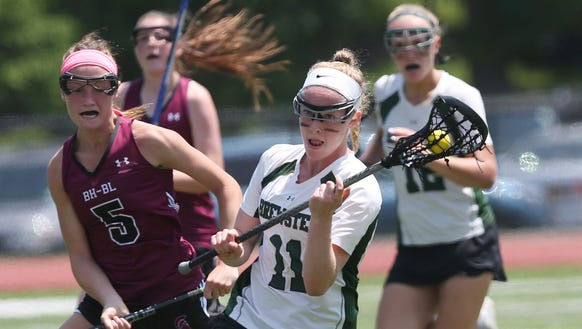 Brewster's Lauren Craft (11) drives to the goal against