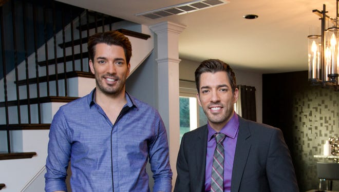 Hosts Jonathan (left) and Drew Scott in a renovated pool house as seen on HGTV's Property Brothers.  The pool house was converted into an entertaining space with lounge area and upstairs movie room.  (portrait)