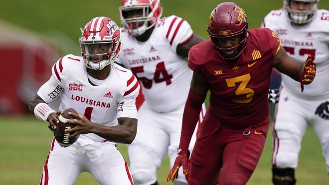 Louisiana quarterback Levi Lewis runs from Iowa State defensive end JaQuan Bailey  during the first half of their game Sept. 12 in Ames, Iowa.