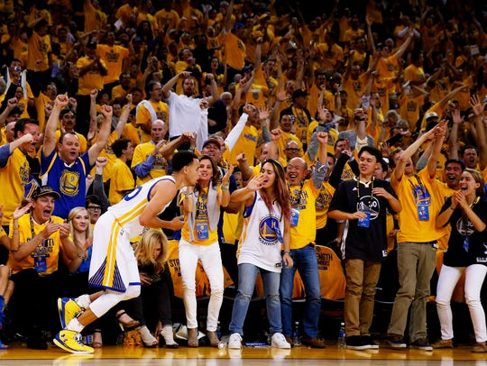 Golden State Warriors fans react after Stephen Curry