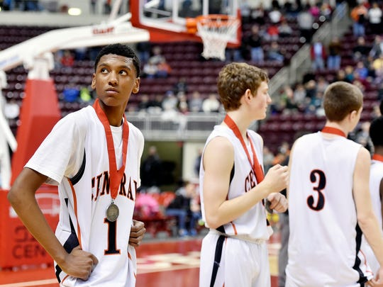 Central York's Courtney Batts keeps his gaze focused on the stands during Reading's championship medal ceremony after the PIAA District 3 Class AAAA boys basketball championship game Saturday, Feb. 27, 2016, at the Giant Center in Hershey. Central York, playing its first district title game since 1984, lost 65-54 to Reading.