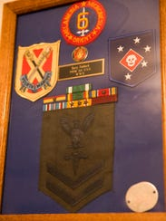 Military patches of Harry Fishback, a World War II