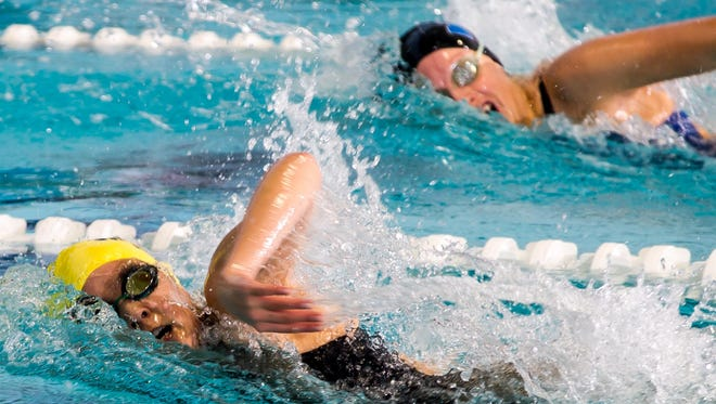 North Brunswick's Melanie Fosko (left) and Metuchen's Macie Schaper swim in the 100 freestyle during the Greater Middlesex Conference Championship on Saturday at the Raritan Bay YMCA in Perth Amboy.