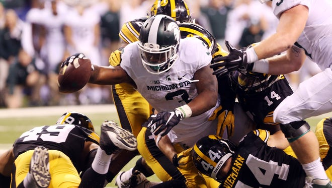 MSU running back LJ Scott dives in for the game-winning touchdown in last season's Big Ten championship game. Scott is the most likely candidate to be this year's featured back, if one is to emerge.