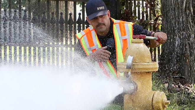 Firefighter, Channing Chronister, Fort Smith Fire Department Pumper 4, test the water flow capacity and operation of a hydrant on S. O St, Monday, August 3, 2020, as part of the fire department's hydrant inspections across the city The testing will be done in a rotation through five districts across the city and will be conducted 8 a.m - 3:30 p.m. Each rotation should take 1-2 weeks and customers may experience a temporary discoloration of water, which is due to the unsettling of rust in the water main.