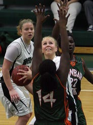 Fort Myers High School's Madison Barker shoots over