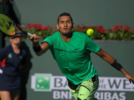 Nick Kyrgios, of Australia, returns a shot to Novak Djokovic, of Serbia, at the BNP Paribas Open tennis tournament, Wednesday, March 15, 2017, in Indian Wells, Calif. (AP Photo/Mark J. Terrill)