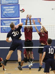 Wayne Valley (in blue), shown battling Bloomfield in the 2016 North 1 boys volleyball semifinals, must overcome graduation losses to defend its North 1 title.