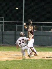 Nutley's Dan DiAntonio sliding into home plate in a