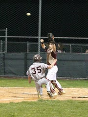 Nutley's Dan DiAntonio sliding into home plate in a