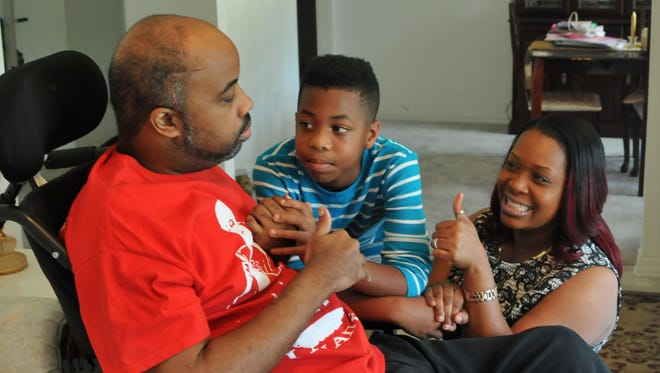 "Despite limited movement, he can give a ""thumbs up."" Ron Greene, pastor at Destiny Life Church in Melbourne, has suffered a series of strokes this year. He is seen here with his son Israel, 10, and wife, Pastor Tanya Greene."