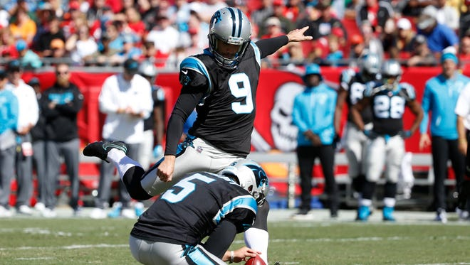 Carolina Panthers kicker Graham Gano (9) kicks the ball for a field goal and punter Michael Palardy (5) holds the ball against the Tampa Bay Buccaneers during the first half at Raymond James Stadium.