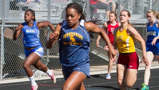 Jaslyn Gardner, from Enterprise High, competes in the girls 100-meter at the Region 9 track meet at Desert Hills High School Saturday, April 16, 2016.