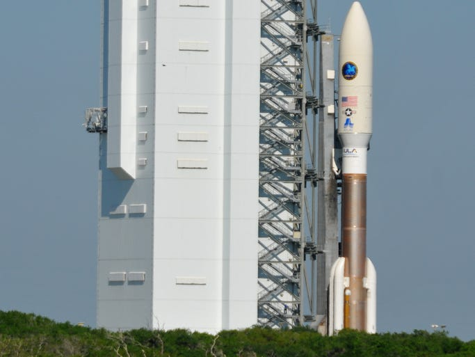 An Atlas V rocket is rolled out to its Cape Canaveral launch pad on Wednesday, April 9, 2014.