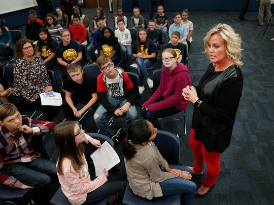 Jennifer McCormick, Superintendent of Public Education talks with students at the Blue Academy in Decatur Township Tuesday, Oct. 23, 2017. Indiana Governor Holcomb, Jennifer McCormick, Superintendent of Public Education and Evan Marwell, EducationSuperHighway CEO announced the partnership that will provide 38,500 Indiana students with faster internet in schools.
