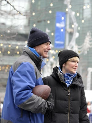 """Tom Behr and his wife, Lynn, of Linden, walk through Campus Martius before attending the Lions game on Saturday afternoon. """"We were adamant to get here today despite weather and traffic. We hit Eastern Market, our nephews are really excited to hit (Player One) arcade and skating in Campus Martius has been on my bucket list for so long because I see so many videos here,"""" said Lynn Behr."""