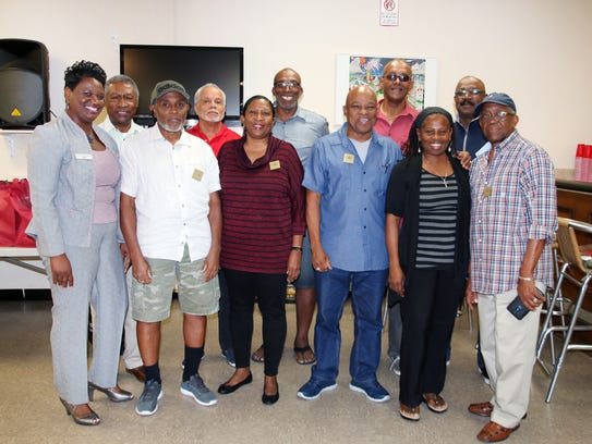 Members of the Jerk Festival Committee, from left,