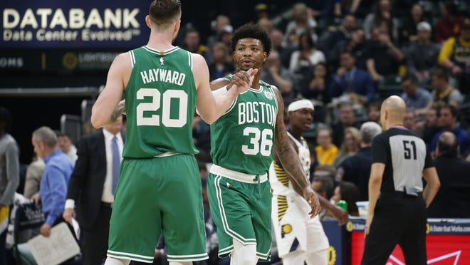 Mar 10, 2020; Indianapolis, Indiana, USA;  Boston Celtics guard Marcus Smart (36) is congratulated by forward Gordon Hayward after a play against the Indiana Pacers during the first quarter at Bankers Life Fieldhouse. Mandatory Credit: Brian Spurlock-USA TODAY Sports