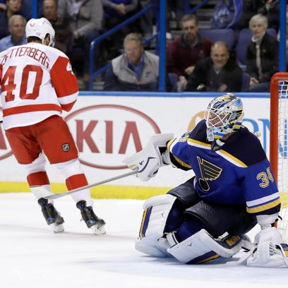 St. Louis Blues goalie Jake Allen, right, is slow to