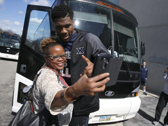 Xavier's Jalen Reynolds takes a selfie with Xavier employee Vonnya Thomas as the Musketeers leave Cintas Center Wednesday, March 16, 2016 for the NCAA Tournament in St. Louis.