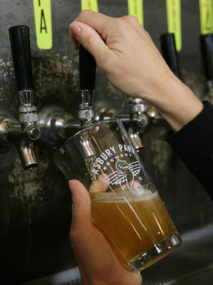 Jennifer Gilmartin of Shrewsbury, operations manager, pours an XPA, a West Coast-style pale ale, at the Asbury Park Brewery in Asbury Park in 2017.