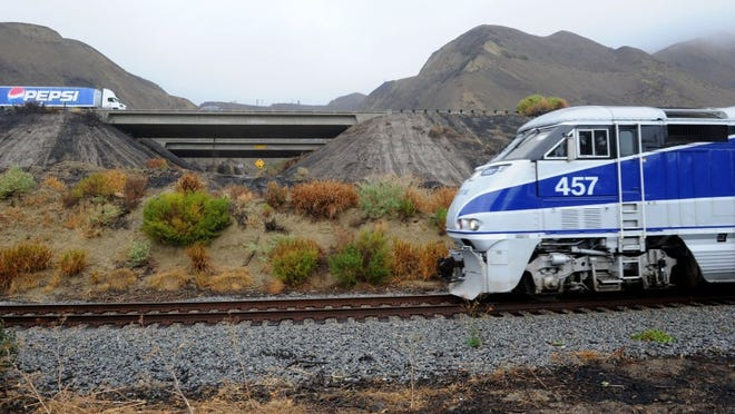 STAR FILE PHOTO An Amtrak train travels north near Highway 101 in the Solimar Beach area in 2016.