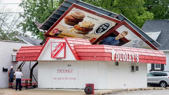 A billboard blown over by high winds lies on top of the Dudley's ice cream shop, 2624 N. Sheridan Road in Peoria after a severe thunderstorm Monday, Aug. 10, 2020 knocked down trees and power lines throughout the area.