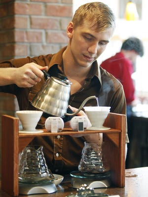 Benjamin Turiano of Rochester takes care of the first steps to make a Cold Brew at Joe Bean Coffee Roasters in Rochester on Thursday June 23, 2011