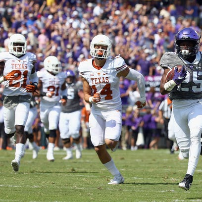 Texas Longhorn Dylan Haines #14 chases down a TCU defender