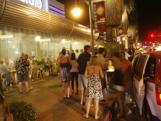 Visitors to downtown Palm Springs are dropped off on a Saturday night in August 2011.