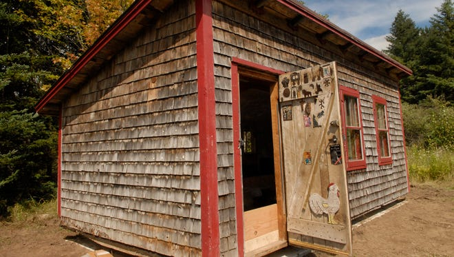 The Coop, the studio of the late award-winning writer Norbert Blei has found a new home behind the Write On building, 4177 Juddville Road in Juddville. It was moved to its new location Tuesday.