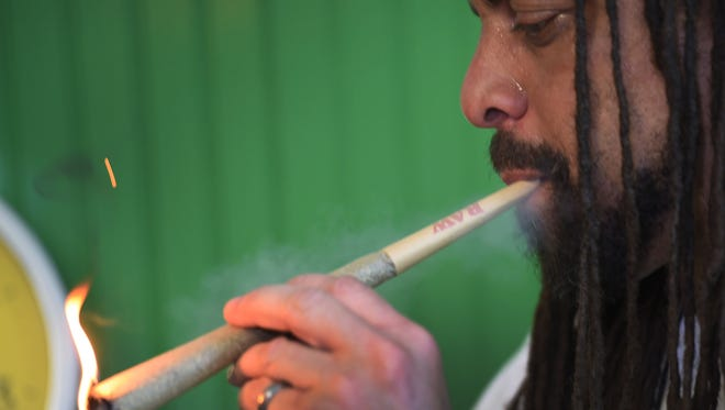 """Ed """"NJWeedman"""" Forchion, owner of NJWeedman's Joint, who is one of two of the most prominent black marijuana activists in New Jersey, talks for diversity in legal weed as he smokes marijuana during an interview at NJWeedman's Joint in Trenton on 06/13/18."""